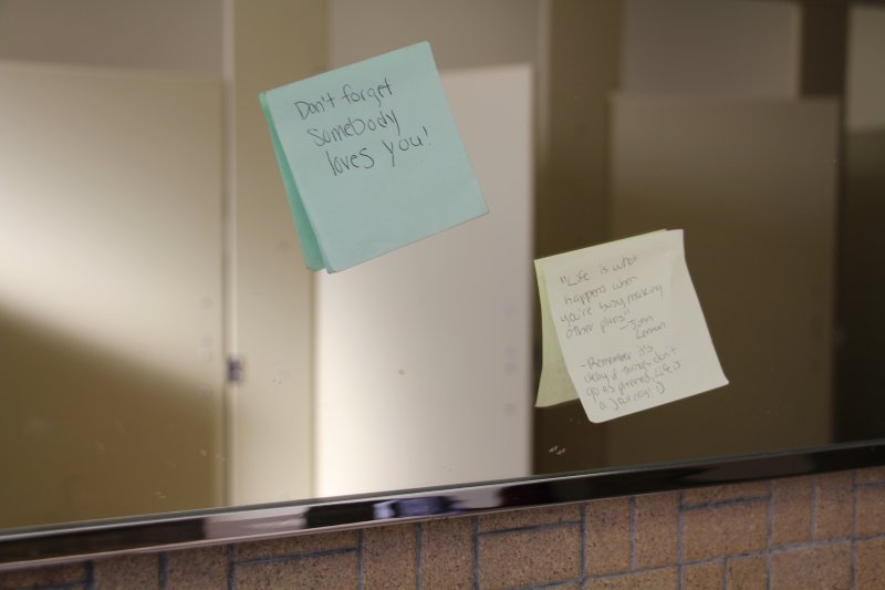 Mysterious, inspiring notes stick across campus restrooms by Tracy Geibel