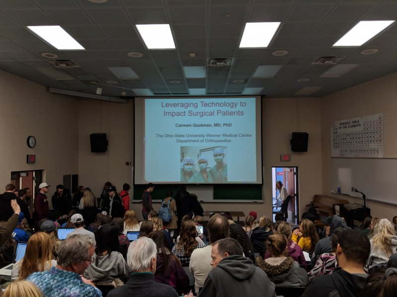 Doctor and alumna lectures on medical research performed by Rick Chernicky